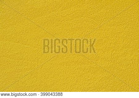 Yellow Background With A Textural Surface. Yellow Fabric, Fleece.