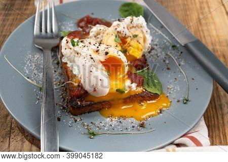 Poached Eggs With Spread Yolk. Egg Yolk On A Plate.