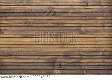 A Fine Wood Background In Dark Brown Tone. In Horizontal Position. Texture And Detail Of Wood Fence.