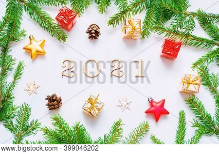 Christmas and New Year 2021 background with 2021 figures, Christmas toys, green fir branches-New Year 2021 composition Concept of New Year 2021 holiday with New Year objects. Flat lay, top view of 2021 still life