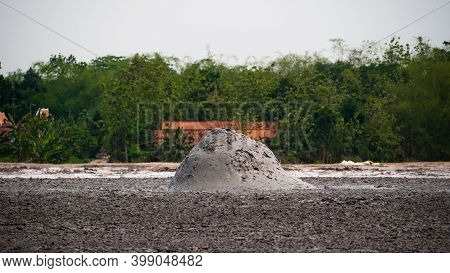 Mud Volcano With Bursting Bubble Bledug Kuwu. Volcanic Plateau With Geothermal Activity And Geysers,