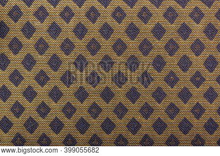 Yellow Fabric With Blue Lozenges As The Background Texture. Close-up Long And Wide Texture Of Natura
