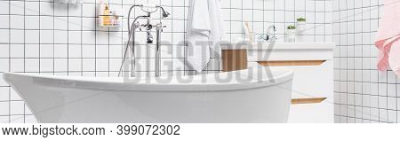 Bathtub In Modern Bathroom With Towels And Toiletries, Banner