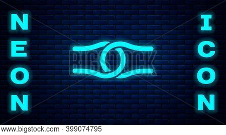 Glowing Neon Rope Tied In A Knot Icon Isolated On Brick Wall Background. Vector