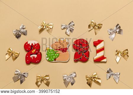 Numbers 2021 From Gingerbread Cookies In A Multicolored Glaze On A Beige Background. The Symbol Of T