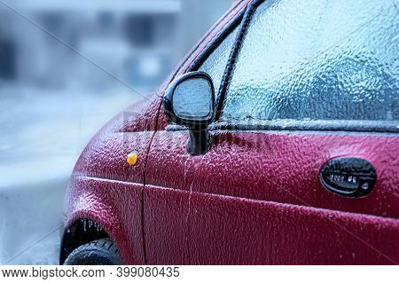 Car Body And Side-view Mirror Froze After Freezing Rain. Abnormal Weather, Freezing Rain Covered The
