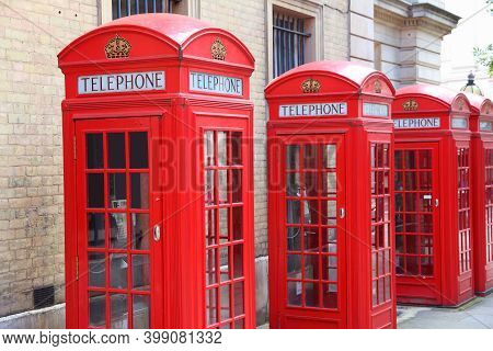 London Telephone Boxes Row. London Landmarks - Red Phone Booth.