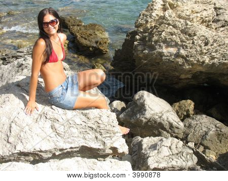 Girl Sitting On The Rock