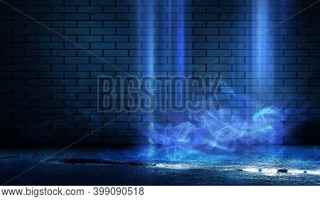 Dark Brick Wall, Blue Neon Light. Rays And Glare Of Light In The Dark. Night View Of A Dark Street,