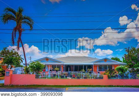 Grand Cayman, Cayman Islands, July 2020, View Of A Salmon Color House In George Town