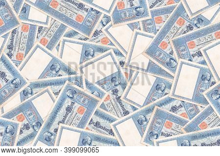 100 Reich Marks Bills Lies In Big Pile. Rich Life Conceptual Background