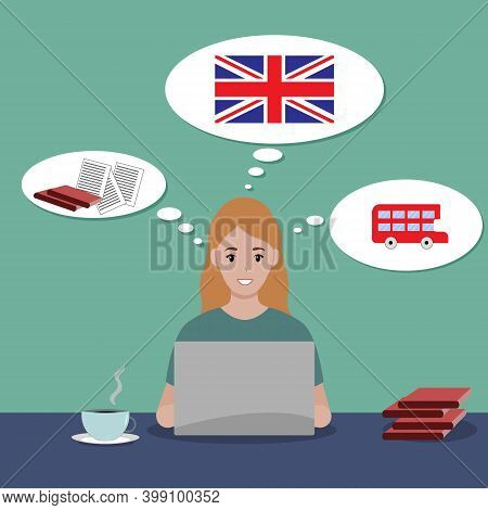 The Girl Is Sitting At A Laptop And Studying English Online. A Gracious Girl Sits At A Table With Te