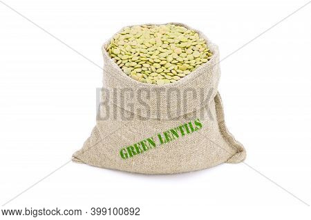 Green Lentils In A Sack Isolated On A White Background. Green Lentils In A Burlap Sack. Healthy Food