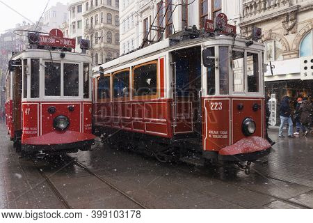 Istanbul, Turkey - January 31, 2012 : Nostalgic Trams Were Passing By Istiklal Street When Snowfalls