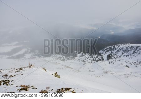 Snowy Winter In The Ukrainian Carpathian Mountains With Traveling Tourists