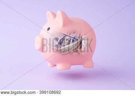 Piggy Bank And Us Dollar Bills Inside. Symbol Of Investments, Saving Money. Growth Earnings Concept.