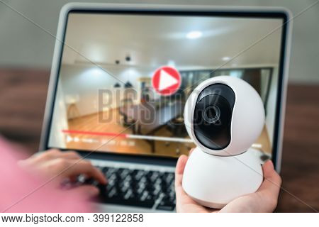Hand Holding Cctv Camera And Using Laptop With Looking Video Record, Surveillance Technology.
