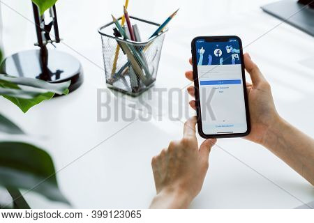 Bangkok, Thailand - December 12, 2020 : Hand Is Pressing The Facebook Screen On Apple Iphone 11, Soc