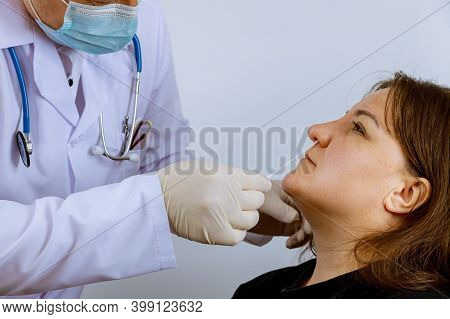 Doctor Worker Taking A Swab A Coronavirus Covid-19 Test A Nasal Sample For Medical Examination For I