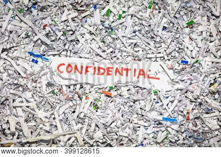 Concept of shredding confidential information to protect identity theft.