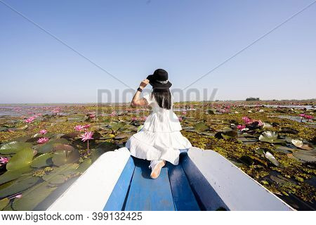Asian Tourist Woman On A Blue Long Tail Boat At Amazing Red Lotus Sea. Unseen In Thailand, Tourism T