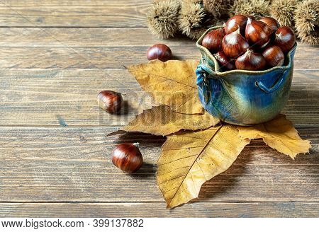 Chestnuts On An Old Wooden Table