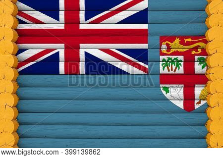 National Flag  Of Fiji On A Wooden Wall Background. The Concept Of National Pride And A Symbol Of Th