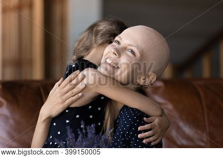Close Up Smiling Hairless Woman Cancer Patient Hugging Little Daughter