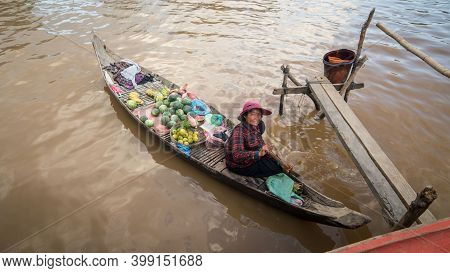 Tonle Sap Lake, Cambodia - December 2015: Cambodian Selling Food In Her Boat At Floating Village Of