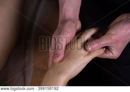 Massagist Man Scrubbing Womans Hand And Fingers Natural Scrub In Spa Salon. Procedure Of Peeling And
