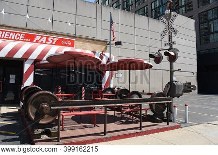April 16, 2020, Chicago, Il Fast Track Restaurant With Railroad Themed Railroad Crossing Sign And Tr