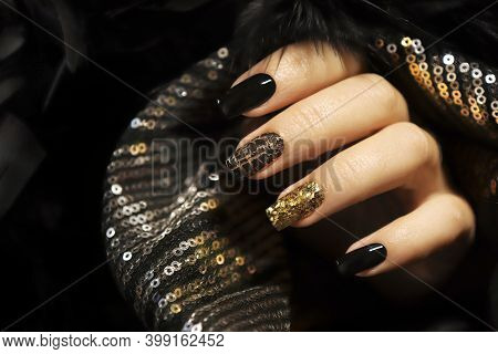 Holiday Manicure On Long Square Nails With Golden Sequins, Black Shiny Nail Polish And Craquelure Ma