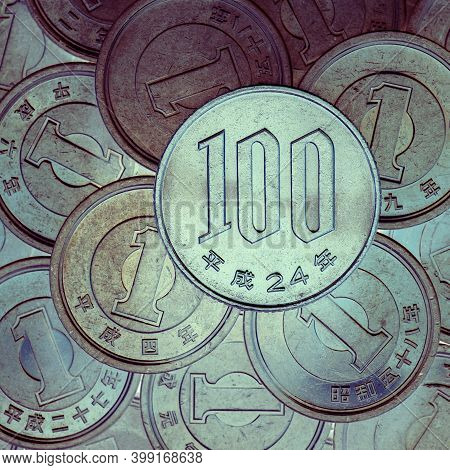 100 Yen Lies On A Pyramid Of Japanese 1 Yen Coins. View From Above. Inverted Colors. Square Unusual