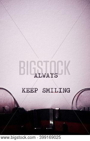 Always keep smiling phrase written with a typewriter.