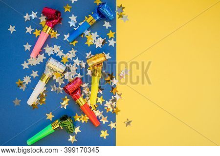 Birthday Party Whistles On Color Background.colorful Celebration Pattern With Party Blower Horns. Mi