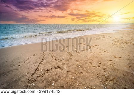 Happy New Year 2021 Text On Beautiful The Sea Beach With Wave Early Morning Sunrise Over The Horizon