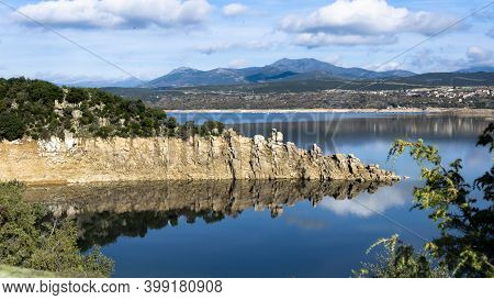 Landscape Of The Atazar Reservoir In Madrid, Spain. Detail Of The Rock On The Reservoir That Reflect