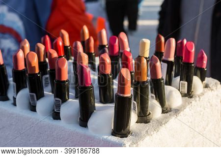 Street sale of cheap cosmetics at the clothing market. Different colors of lipstick.