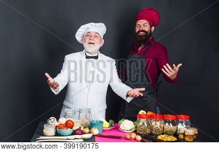 Kitchen Battle. Two Chefs. Beared Chef Man. Delicious Food. Male Chef In Uniform. Satisfied Bearded