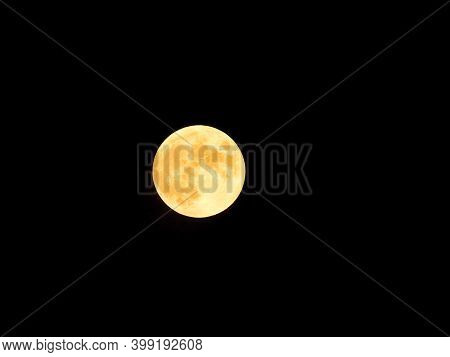 Full Moon Lights Up Dark Sky With Yellow Moon Light In Closeup Of Full Moon Astronomy