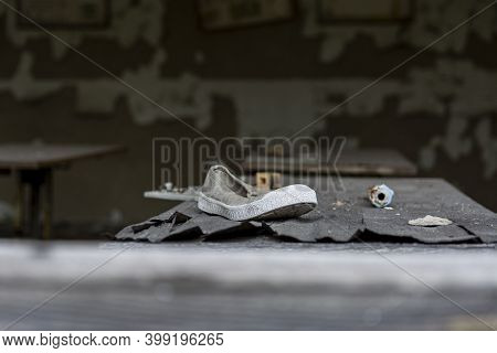 A Sneaker On A School Desk In An Abandoned School In The Chernobyl Exclusion Zone
