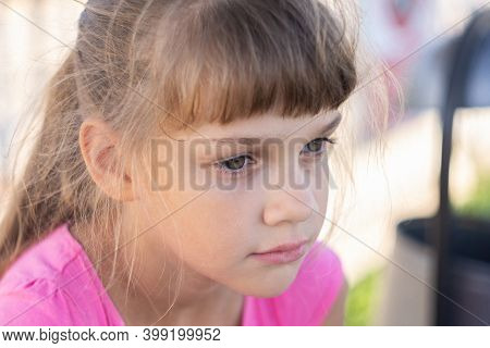 Portrait Of A Pensive European Girl Eight Years Old