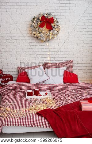 Cozy Decorated Bedroom For Christmas Holidays With Xmas Wreath Tree. Spacious White Light Bedroom In