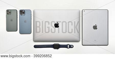 Stariy Oskol, Russia - December 10, 2020: Set Of Apple Company Device Of Macbook Air, Ipad, Iwatch A