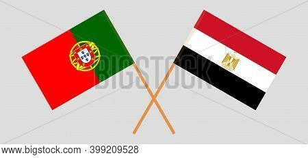 Crossed Flags Of Egypt And Portugal. Official Colors. Correct Proportion. Vector Illustration