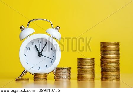 Stacks Of Coins In Row Ascending And Alarm Clock. Time Is Money, Efficient Business, Great Income In