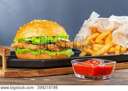 Hamburger With Chicken Nuggets And French Fries On Plate.