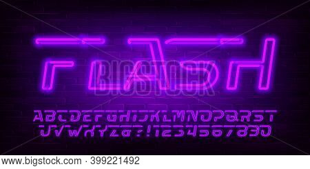 Flash Alphabet Font. Purple Neon Light Letters, Numbers And Symbols. Brick Wall Background. Stock Ve