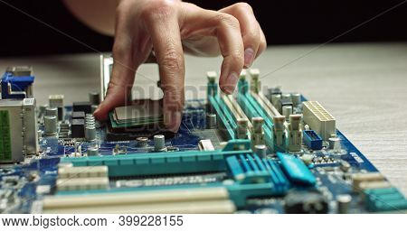A Gloved Holds A Processor. Close-up Presentation Of A New Generation Microchip. Gloves Holding Piec