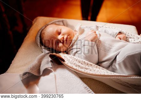 A Baby Fell Asleep On A Dressing Table In A Church. The Ordinance Of Baptism.